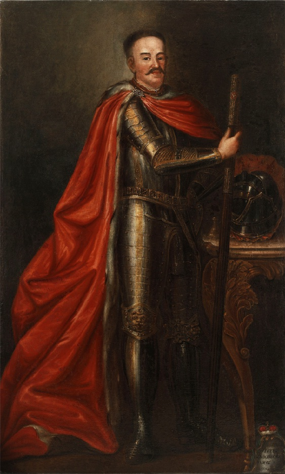 Lubomirski standing in armor and red cape, with a long staff